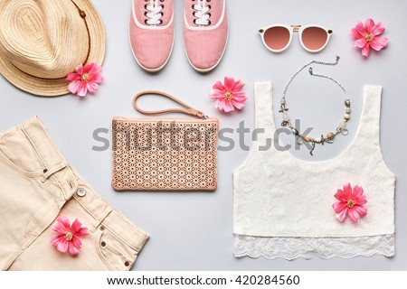Summer. Summer street style. Summer Fashion girl clothes set, accessories. Trendy sunglasses, gumshoes, top, handbag clutch, necklace hat,flowers. Summer lady. Creative urban overhead. Summer top view