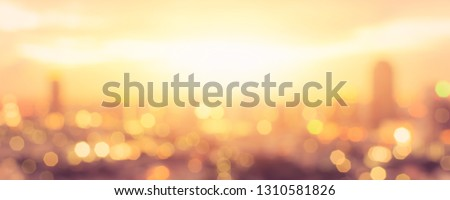 Summer sun blur golden hour hot sunset sky with city rooftop view background cityscape office building landscape blurry urban warm bright heat wave lights skyline heatwave bokeh for evening party