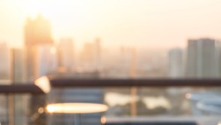 Summer sun blur golden hour sky sunset with city rooftop view  background cityscape office building landscape blurry urban lights skyline bokeh for evening party