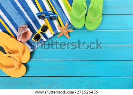 Summer sunbathing beach background, sunglasses, flip flops, copy space