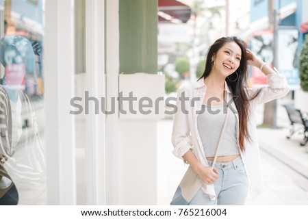 Summer sunny lifestyle fashion portrait of young stylish hipster Asia woman walking on the street, wearing cute trendy outfit #765216004
