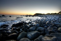 Summer Sunrise over a pebble beach in Forster