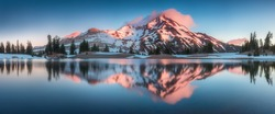 Summer Sunrise South Sister mountains in central Oregon near Bend are reflected in Green Lakes. Mountains in the cascade Range of Oregon, USA Beautiful landscape background