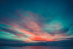Summer sunset in Antarctica. Dramatic colourful cloudy sky above ocean and glaciers. Beautiful nature background