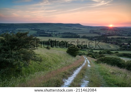 Stock Photo Summer sunset landscape overlooking English countryside