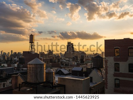 Summer Sunset light on Chelsea rooftops, the Walker Tower, and water towers. Manhattan, New York City #1445623925