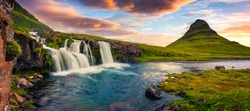 Summer sunset on famous Kirkjufellsfoss Waterfall and Kirkjufell mountain. Colorful evening panorama of Snaefellsnes peninsula, Iceland, Europe. Artistic style post processed photo.
