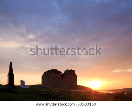 Summer sunset view of ancient  Crimean fortress (near Sevastopol Town, Crimea, Ukraine) and monument on grave of world war heroes