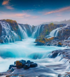 Summer sunset with unique waterfall - Bruarfoss. Colorful evening scene in South Iceland, Europe. Artistic style post processed photo.
