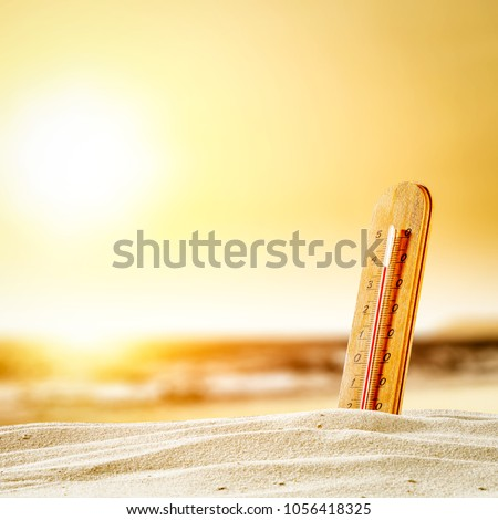 Summer thermometer on beach and free space for your decoration.