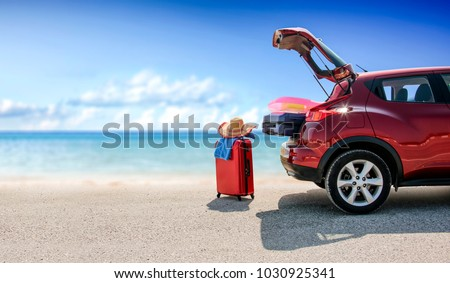 summer time and red car on...