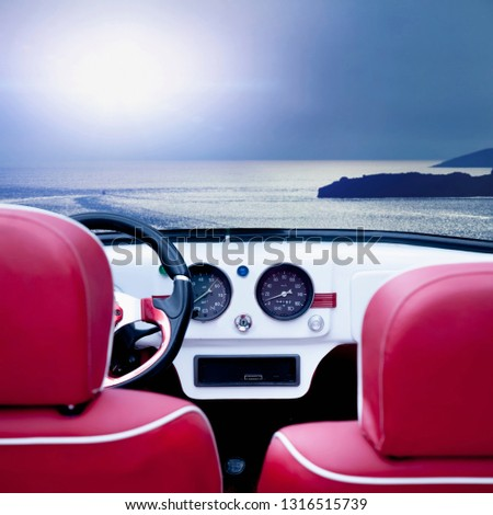 Summer time and red retro car on beach. Interior of classic vintage car against sea background. Travelling, rest, holiday concept. #1316515739