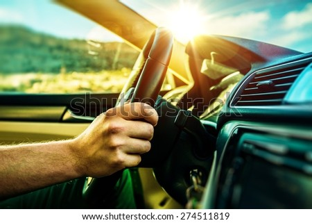 Summer Time Car Trip. Car Traveling. Men Driving Down the Road During Scenic Sunset.