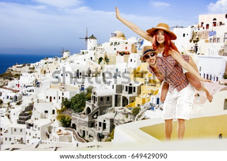 Summer time in Santorini and two lovers  #649429090
