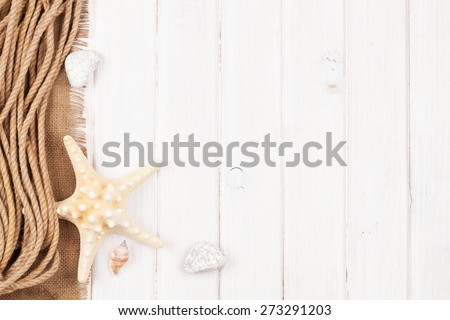 Summer time sea vacation background with star fish, marine rope and copy space
