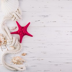 Summer time sea vacation white wooden background with star fish, marine rope and copy space