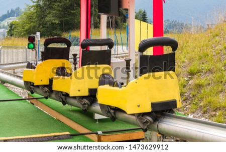 Summer toboggan sled at summer sunny day. Recreational rail transport for leisure activity #1473629912