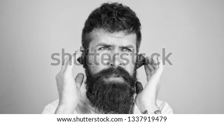 Summer top radio chart. Man bearded hipster red ripe strawberry ears as headphones. Summer hit concept. Guy enjoy juicy sound summer hit song music. Hipster beard listen music strawberry earphones.