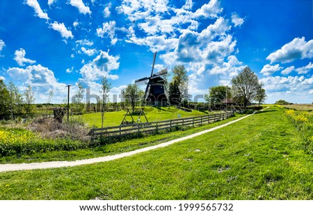 Summer trail to the village. Summer in village. Village in summertime. Summer green village landscape