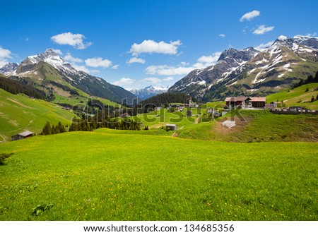 Summer tranquill mountain view to Biberkopf mount (Warth, Vorarlberg, Austria). Beautiful natural vacation hiking walking travel to nature alps destinations concept.