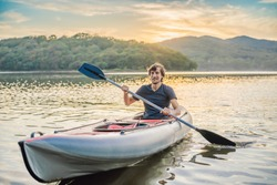 Summer Travel Kayaking. Man Paddling Transparent Canoe Kayak, Enjoying Recreational Sporting Activity. Male Canoeing With Paddle, Exploring Sea On Vacation. Rowing Water Sports