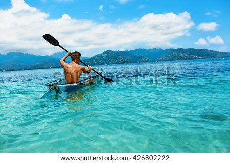 stock photo summer travel kayaking man paddling transparent canoe kayak in tropical ocean enjoying 426802222 - Каталог — Фотообои «Море, пляж»