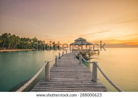 Shutterstock Summer, Travel, Vacation and Holiday concept - Wooden pier between sunset in Phuket, Thailand.