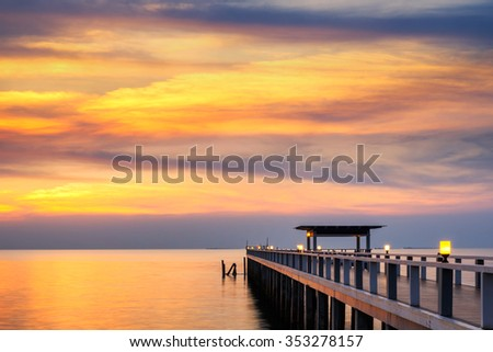 Summer, Travel, Vacation and Holiday concept - Wooden pier between sunset in Phuket, Thailand #353278157