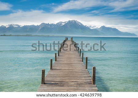 Summer, Travel, Vacation and Holiday concept - Wooden pier in lake at Switzerland #424639798