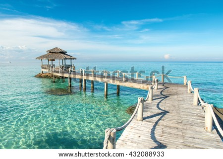Summer, Travel, Vacation and Holiday concept - Wooden pier in Phuket, Thailand. Phuket, Thailand travel, Phuket is province in Thailand.