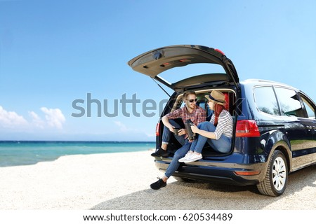 Summer trip on beach by car and two lovers  #620534489