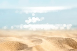 Summer tropical sand beach and bokeh sun light on sea background, copy space.