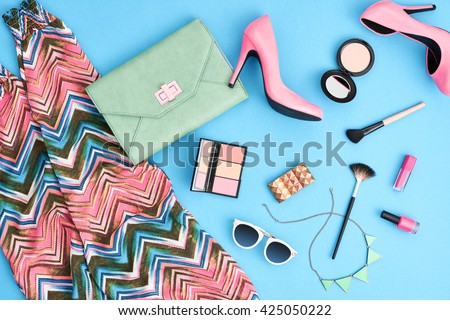 Summer. Urban summer girl colorful outfit.Summer fashion stylish clothes, cosmetics, makeup accessories.Glamor heels, handbag clutch, trendy pants, sunglasses.Summer woman essentials.Unusual, top view