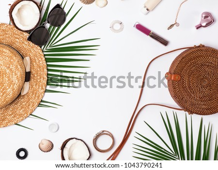Summer vacation accessories on the white background, top view