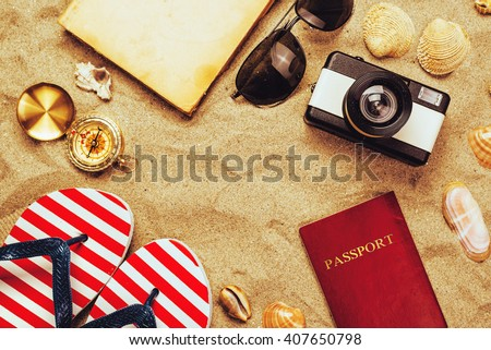 Summer vacation accessories on tropical sandy ocean beach, holidays abroad - summertime lifestyle objects in flat lay top view arrangement