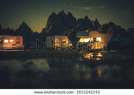 Summer Vacation and Road Trip in Motorhome. Recreational Vehicles RVs Overnight Alpine Camping. Dolomites Misurina, Italy.