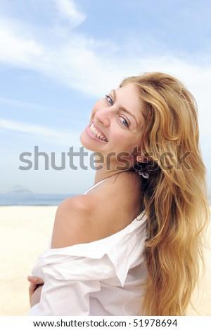 summer vacation: beautiful blond woman enjoying the beach