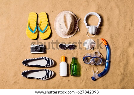 Summer vacation composition. Sandals, hat and other stuff agains #627842393
