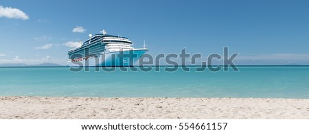 Summer vacation concept: Cruise ship on Caribbean Sea close to tropical beach.