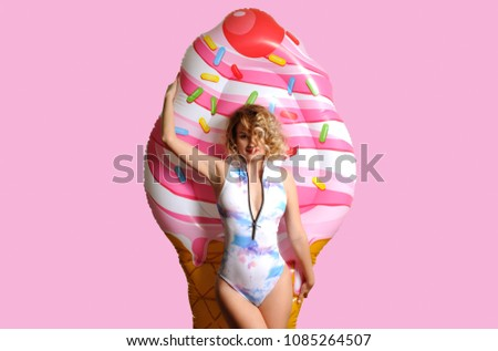 Summer Vacation. Enjoying suntan Woman in bikini with inflatable mattress ice cream #1085264507
