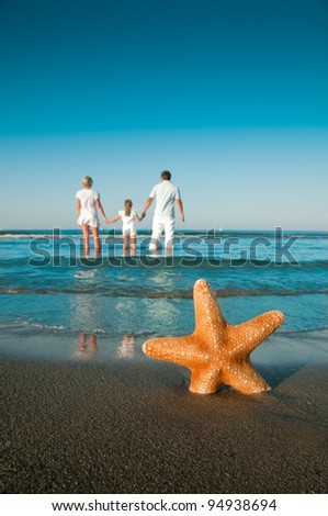 Summer vacation -  family on the beach (space for text)