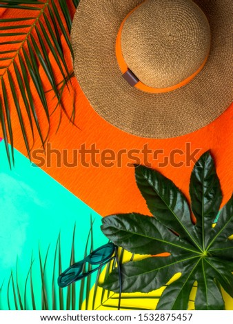 Summer vacation, holiday, travel, tourism concept. Hat, tropical palm leaves on trendy orange, mint, yellow color background. Top view with space for text. #1532875457