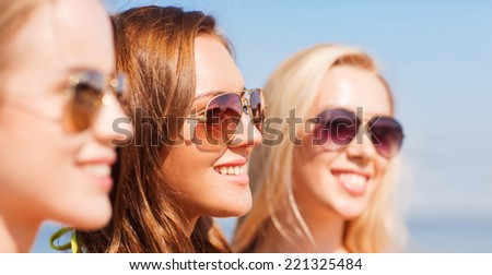 summer vacation, holidays, friendship and people concept - close up of smiling young women in sunglasses #221325484