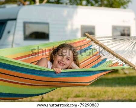 Summer vacation in camping - Cute girl in the colorful hammock