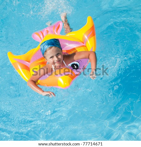 Summer vacation - little girl in blue water (no name toy)