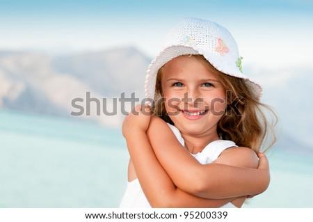 Summer vacation - lovely girl at beach resort