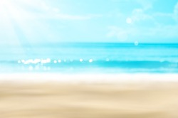 Summer vacation outdoor and travel holiday adventure concept.Copy space blur tropical beach with bokeh sun light wave on blue sky and white cloud abstract background. Vintage tone filter effect color.
