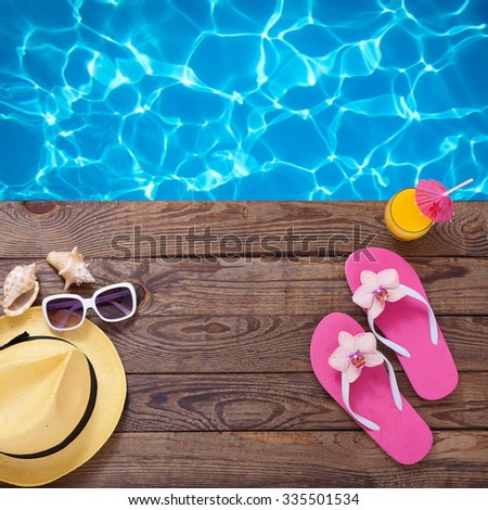 4a0589c45 Summer vacation. Pink flip flops and fashionable clothes sunglasses by  swimming pool. Blue sea