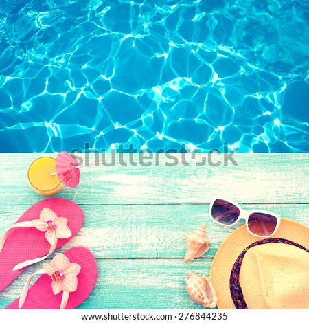 Summer vacation. Pink sandals by swimming pool. Blue sea surface with waves, texture water