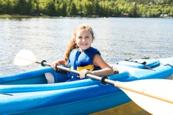Summer vacation Portrait of happy cute girl kayaking the on river